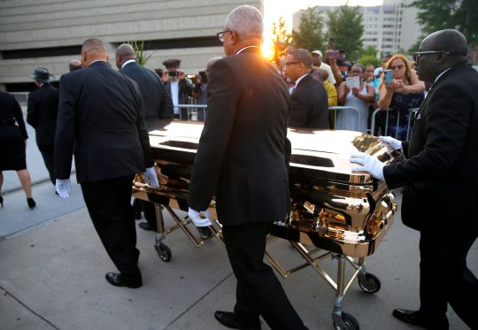 Til the very end, the queen still arrived in style as her gold casket was wheeled past fans