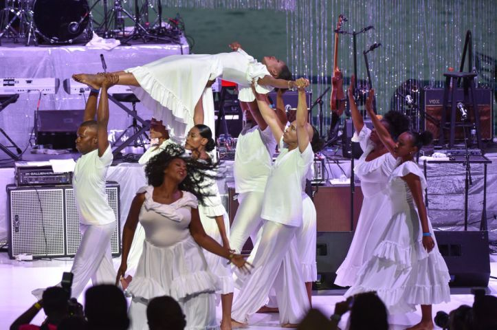 Lisa McCall and dancers perform on stage 1