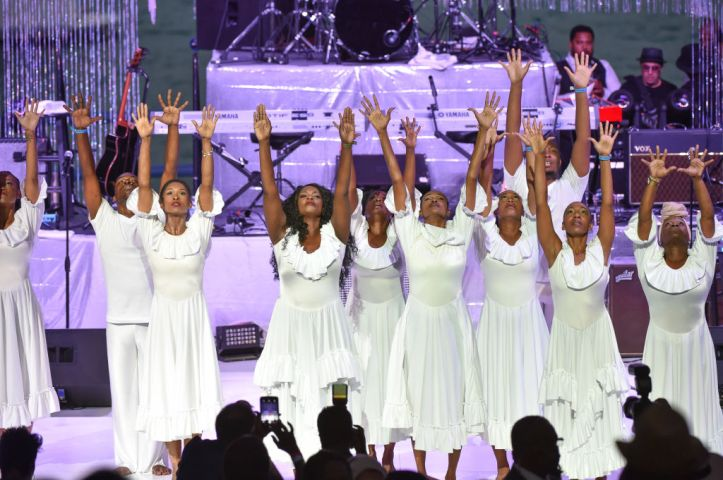 Lisa McCall and dancers perform on stage